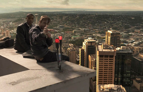RF_056_001_V015.0486 - Steve (Michael B. Jordan, left) and Andrew (Dane DeHaan) sit atop a Seattle skyscraper. (They did not get there via elevator…)